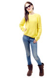 Fashionable charming young woman in stylish jeans and sunglasses Stock Photography