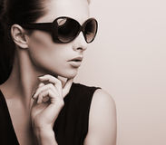Fashionable chic female model profile in fashion sun glasses posing. Black and white portrait
