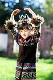 Fashionable child girl with hands over head Royalty Free Stock Photos
