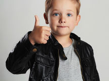 Fashionable child in leather coat.little boy hairstyle. Autumn fashion stock photography