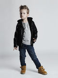 Fashionable child in leather coat.little boy hairstyle. Spring fashion.funny kid stock photos