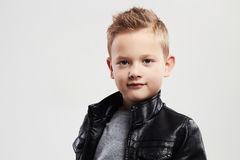 Fashionable child in leather coat.stylish child with trendy haircut Royalty Free Stock Photos