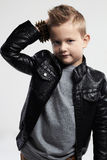 Fashionable child in leather coat.stylish child with trendy haircut Stock Image