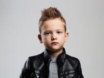 Fashionable child in leather coat.stylish child with trendy haircut Royalty Free Stock Image