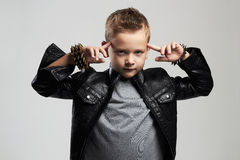 Fashionable child in leather coat.stylish child with trendy haircut Royalty Free Stock Photo