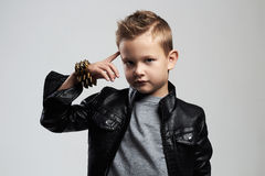 Fashionable child in leather coat.stylish child with trendy haircut Royalty Free Stock Photography