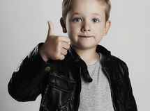 Fashionable child in leather coat.stylish little boy. Autumn fashion. Funny kid royalty free stock photography