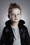 Fashionable child in leather coat.stylish little boy. Autumn fashion.funny 6 years old kid royalty free stock photo