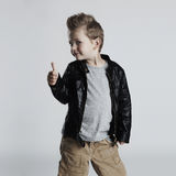 Fashionable child in leather coat.stylish little boy. Autumn fashion Stock Image
