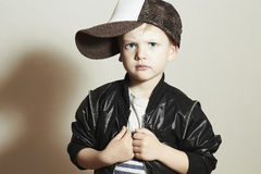 Fashionable Child.stylish little boy in tracker Cap.fashion children. Handsome serious kid with big blue eyes.Tracker Hat. 4 years old royalty free stock photo