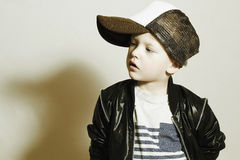 Fashionable Child.stylish little boy in tracker Cap.fashion children.Tracker Hat Royalty Free Stock Photo