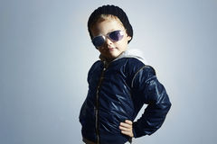Fashionable child in sunglasses.winter style.Posing Little boy.Children fashion Stock Photo