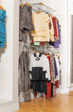 Fashionable children clothes hanging in the shop Stock Photography