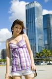 Fashionable Chinese girl in the city. Young female model, pretty Asian girl, fashionable and confident with modern skyscrapers as background royalty free stock photos