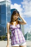 Fashionable Chinese girl in the city Stock Images
