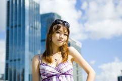 Fashionable Chinese girl in the city Royalty Free Stock Image