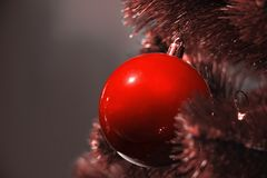 Fashionable Christmas decoration in colour of Living Coral stock image