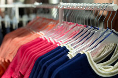 Fashionable clothes on hangers Royalty Free Stock Image