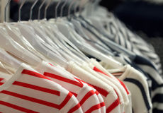 Fashionable clothes on hangers Royalty Free Stock Photography