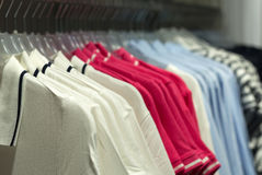 Fashionable clothes on hangers Royalty Free Stock Images