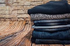 Fashionable clothes. pile of jeans Royalty Free Stock Images