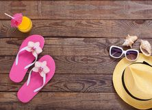 Fashionable clothes sunglasses, hat, flip-flops Stock Images