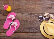 Fashionable clothes sunglasses, hat, flip-flops Stock Images