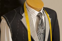 Fashionable collection of rolled-up ties. Stock Photos