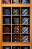 Fashionable collection of rolled-up ties. Stock Photography