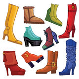 Fashionable colored women's boots and shoes Stock Image