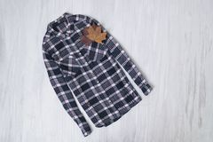 Fashionable concept. Checkered shirt on a wooden background. Fem. Ale wardrobe royalty free stock photography