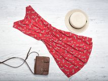 Fashionable concept. Female summer wardrobe. Straw hat, red sund Stock Images