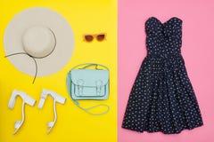 Fashionable concept. Female summer wardrobe. Straw hat, sundress Royalty Free Stock Photography