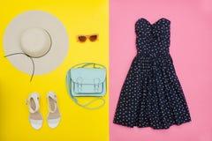 Fashionable concept. Female summer wardrobe. Straw hat, sundress Stock Images