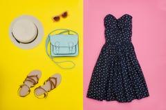 Fashionable concept. Female summer wardrobe. Straw hat, sundress Stock Photos