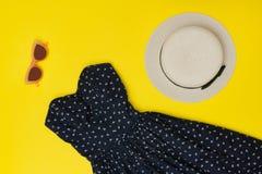 Fashionable concept. Female summer wardrobe. Straw hat, sundress Royalty Free Stock Images