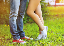 Fashionable cool couple, legs Stock Photos
