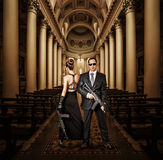 Fashionable couple with automatics Stock Photo