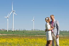 Fashionable couple in field Stock Photos