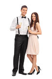 Fashionable couple holding glasses of wine Stock Photography