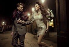 Fashionable couple at nightly walk Stock Images