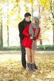 Fashionable couple in park Royalty Free Stock Photography