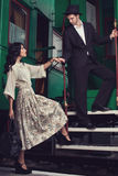 Fashionable couple posing on train car Stock Images