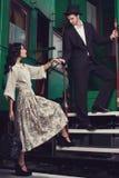Fashionable couple posing on train car Stock Images
