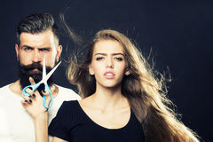 Fashionable couple with scissors Royalty Free Stock Image
