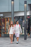Fashionable couple walks in The Village shopping area, Beijing, China Royalty Free Stock Photo