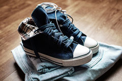 Fashionable denim sneakers Stock Image