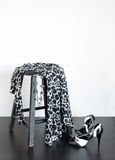 Fashionable dress on old wooden stool Royalty Free Stock Photo