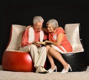 Fashionable elderly couple in studio Stock Images