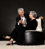 Fashionable elderly couple in studio Stock Photography